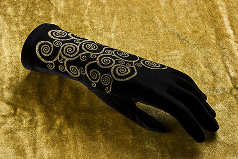 Lace gloves with gold print with black background
